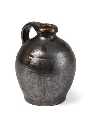 Small Black Glazed Redware Jug.