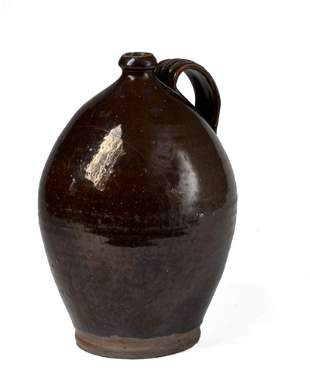 Large Black Glazed Reware Jug.