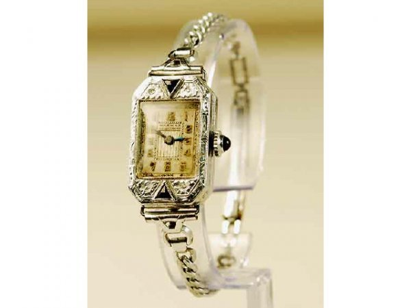 317: 14kt Gold deco Lady's Engraved Wristwatch