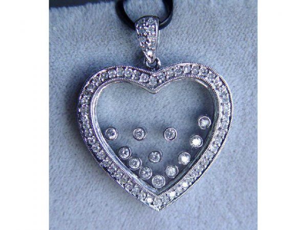 318: 14kt Gold 1ct Diamond Mystery Heart Pendant
