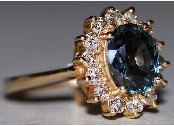 1014: 14kt Gold .5ct Diamond 2.5ct Sapphire Ring