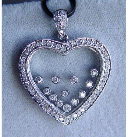 1017: 14kt Gold 1ct Diamond Mystery Heart Pendant