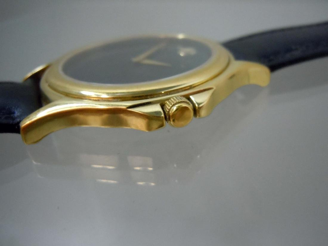 A nice pre-owned Gold Tone Stainless Steel Classic - 2