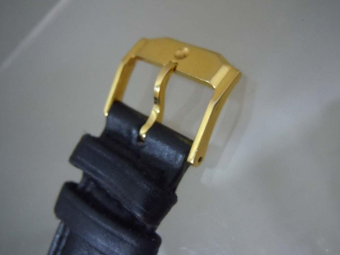 A nice pre-owned Gold Tone Stainless Steel Classic - 6