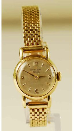 1239: 18kt Gold IWC Lady's Watch 14kt Gold Mesh Band