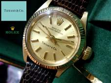 14KT GOLD ROLEX 6917 CHAMPAGNE STICK TIFFANY DIAL WATCH