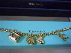 TIFFANY 18KT GOLD CHARM BRACELET ETOILE DIAMOND HEART