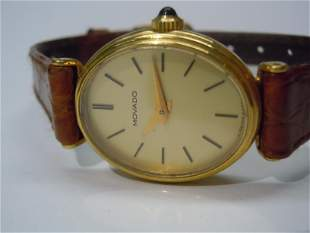 18K GOLD OVAL MOVADO STATEMENT CHAMPAGNE STICK WATCH