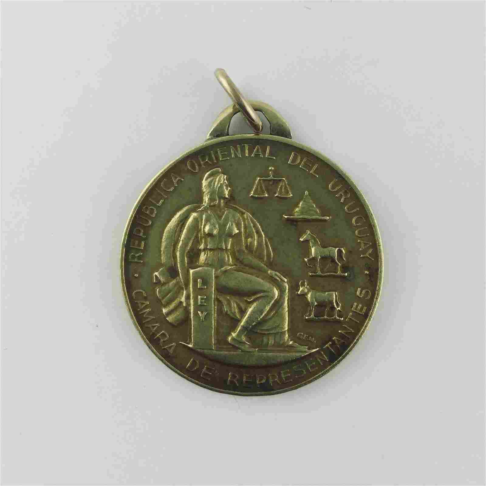 Medal in 18 K yellow gold