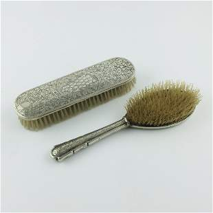 Two Czechoslovakian silver brushes