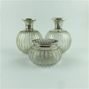An English set of three 1920s jars.