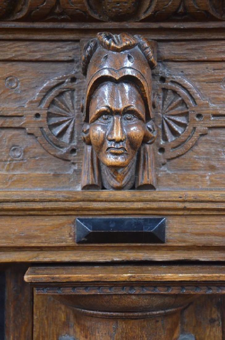 An antique Dutch oak and carved oak press cupboard
