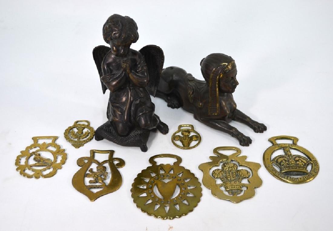 A brown patinated bronze Sphinx, a bronze cherub and