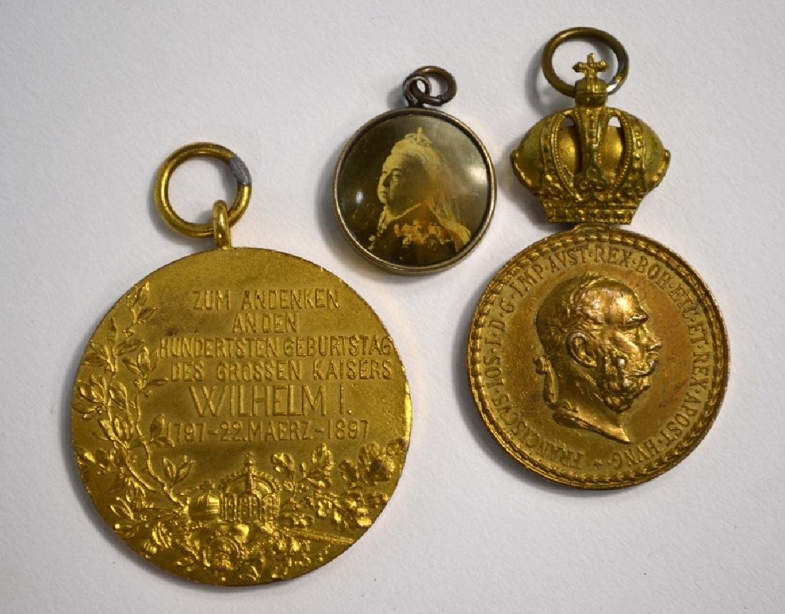 An 1897 German gilt bronze medal and other medals