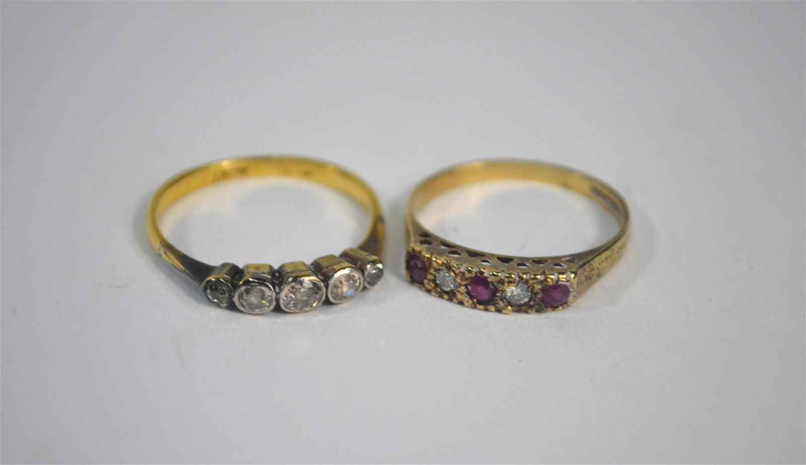 Two five stone rings