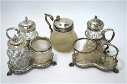 A pair of Victorian silver cruet stands, glass bottles,