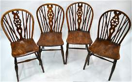 Four matched antique elm and yew Windsor chairs