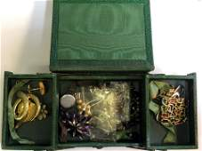 A small  green leather jewellery case containing