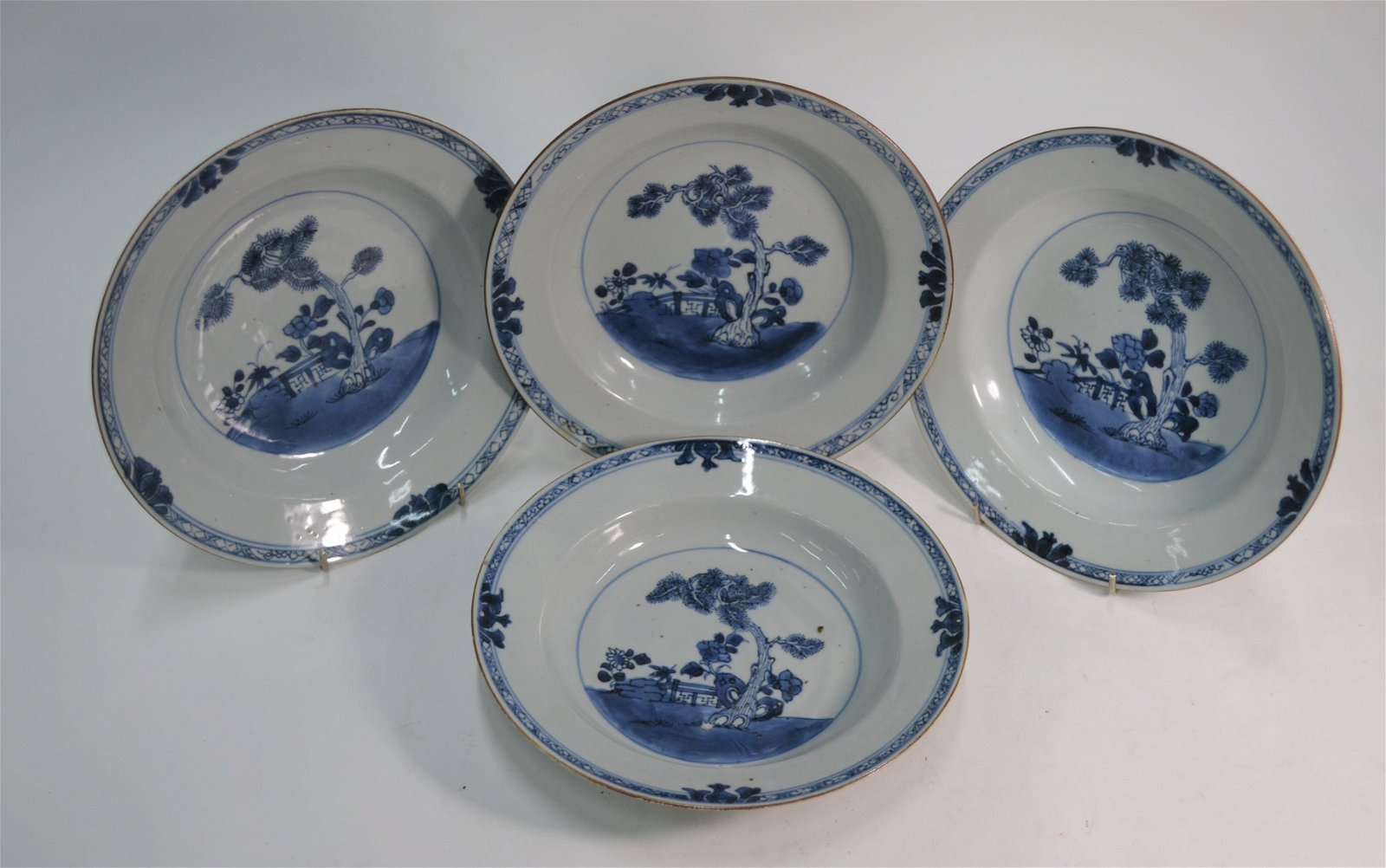 Four Chinese export blue and white porcelain pine tree