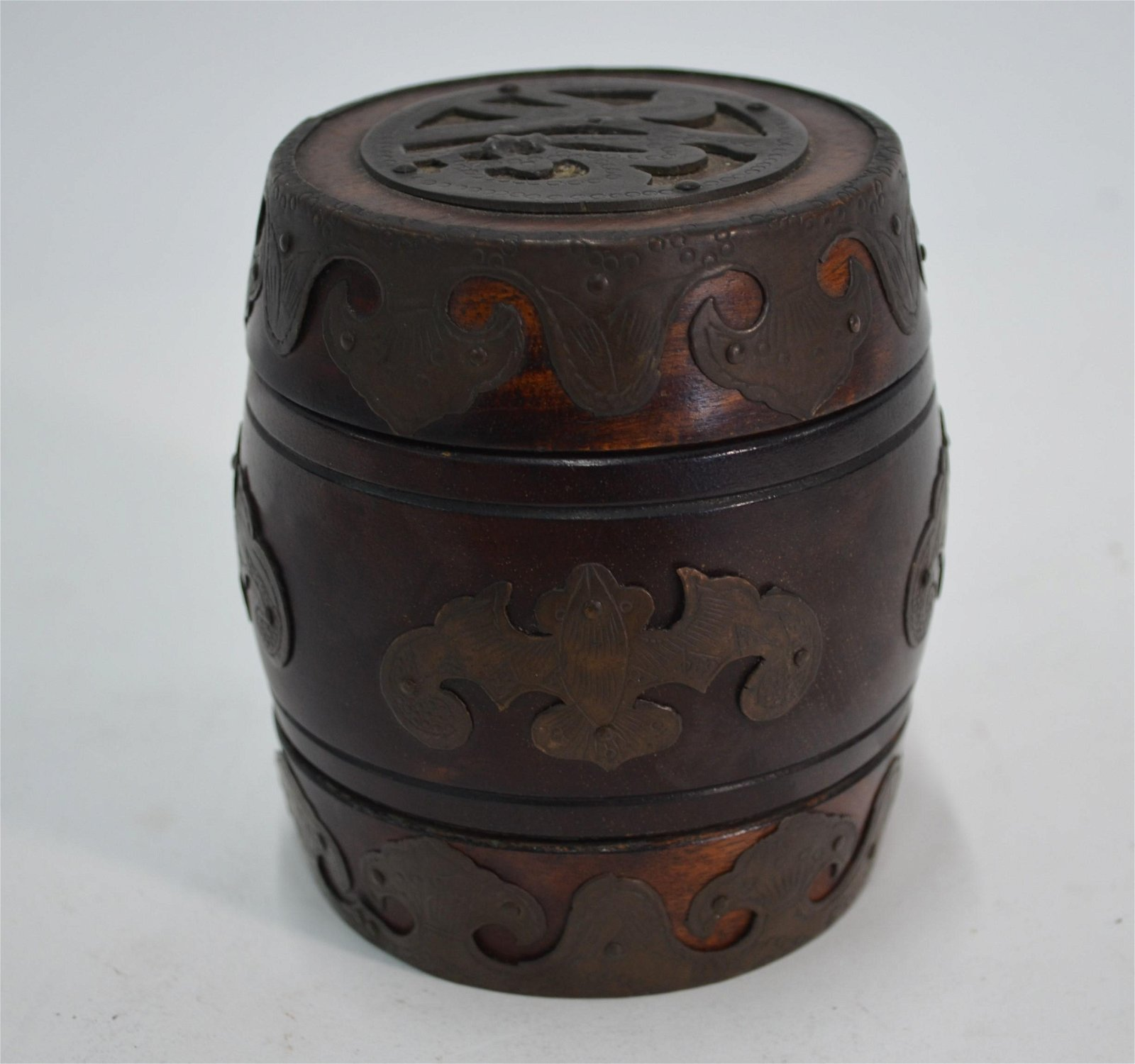 A Chinese hardwood barrel form caddy