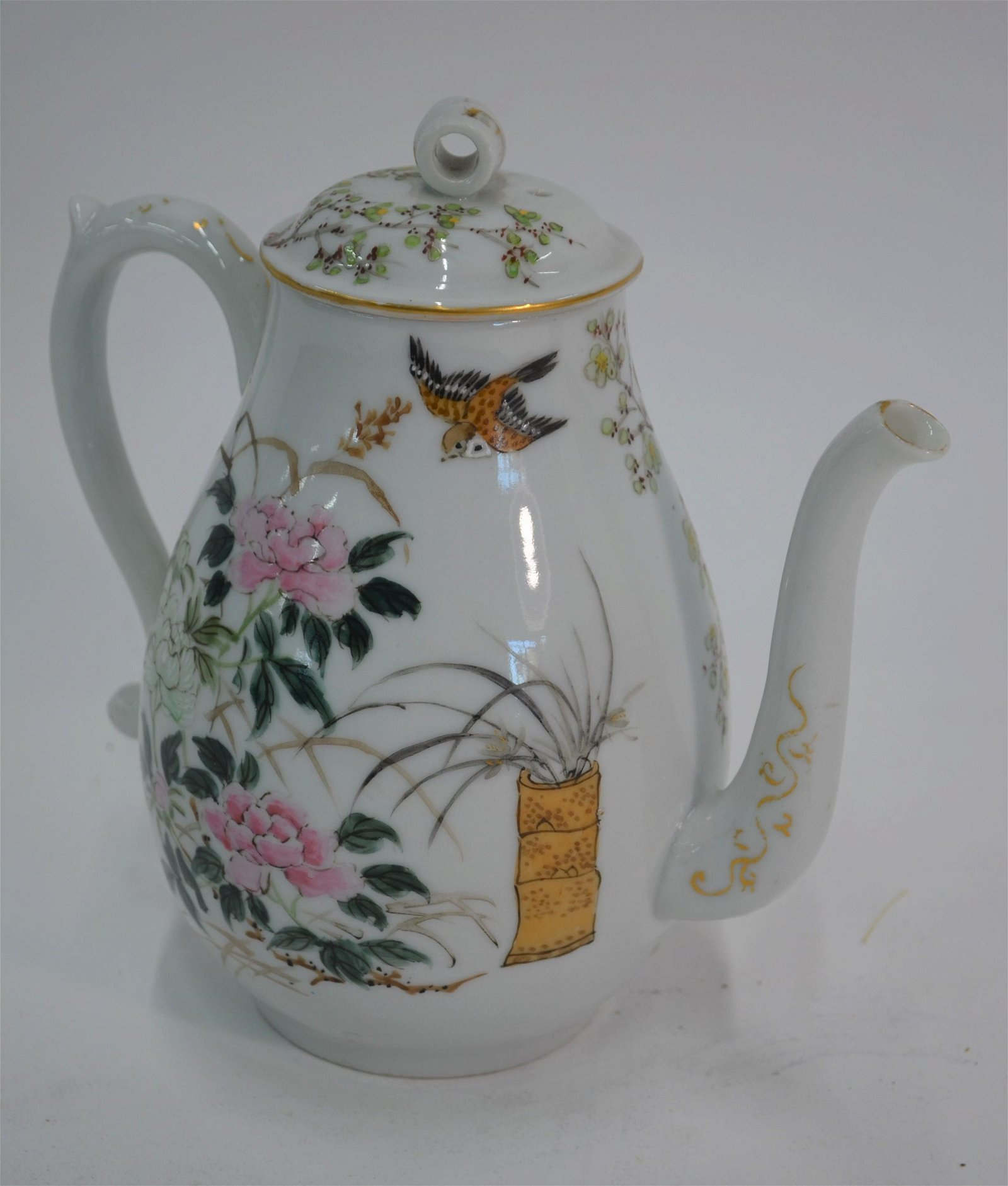 An early 20th century Japanese porcelain coffee pot and