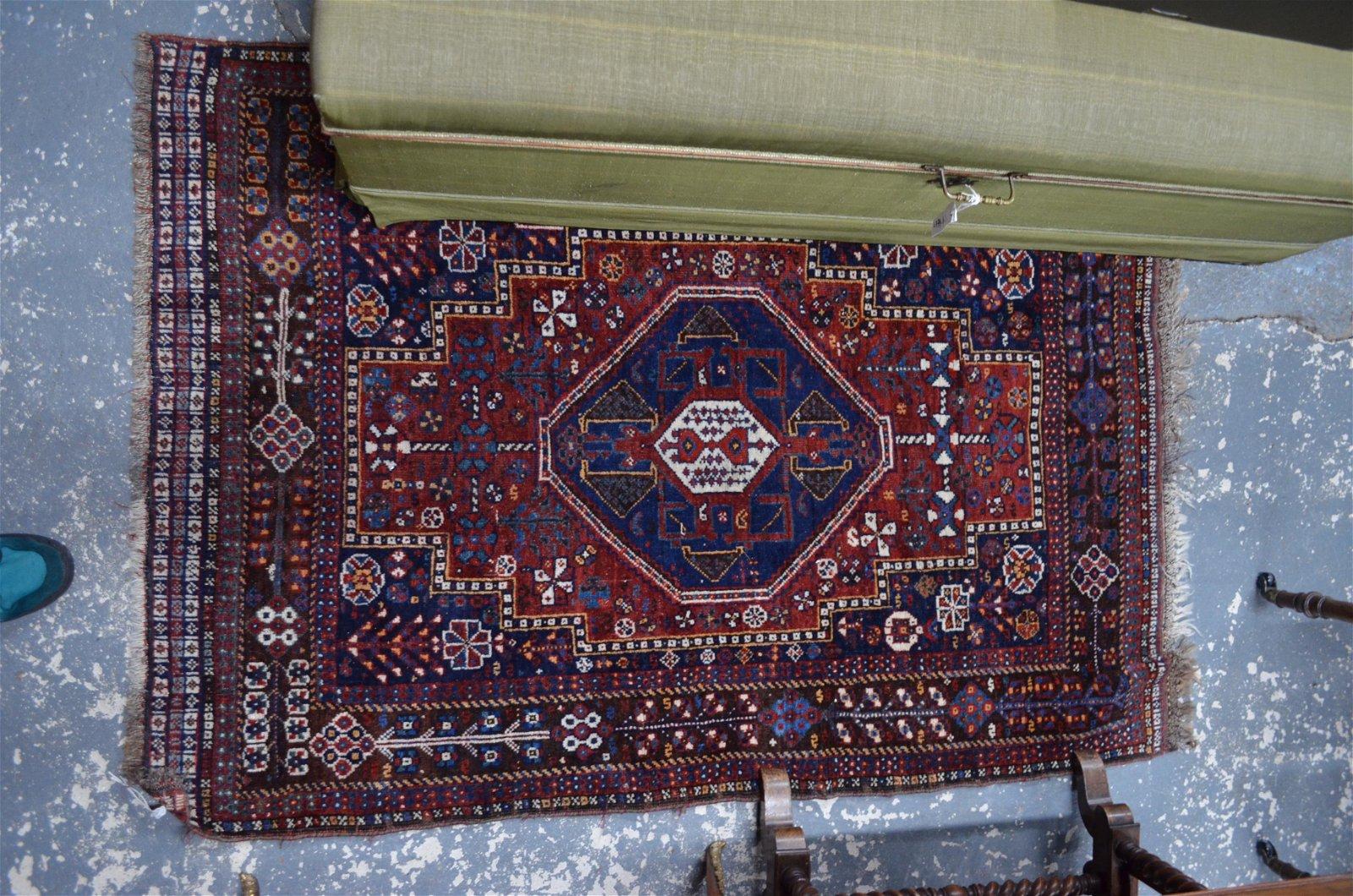 An antique Persian Qashqai rug