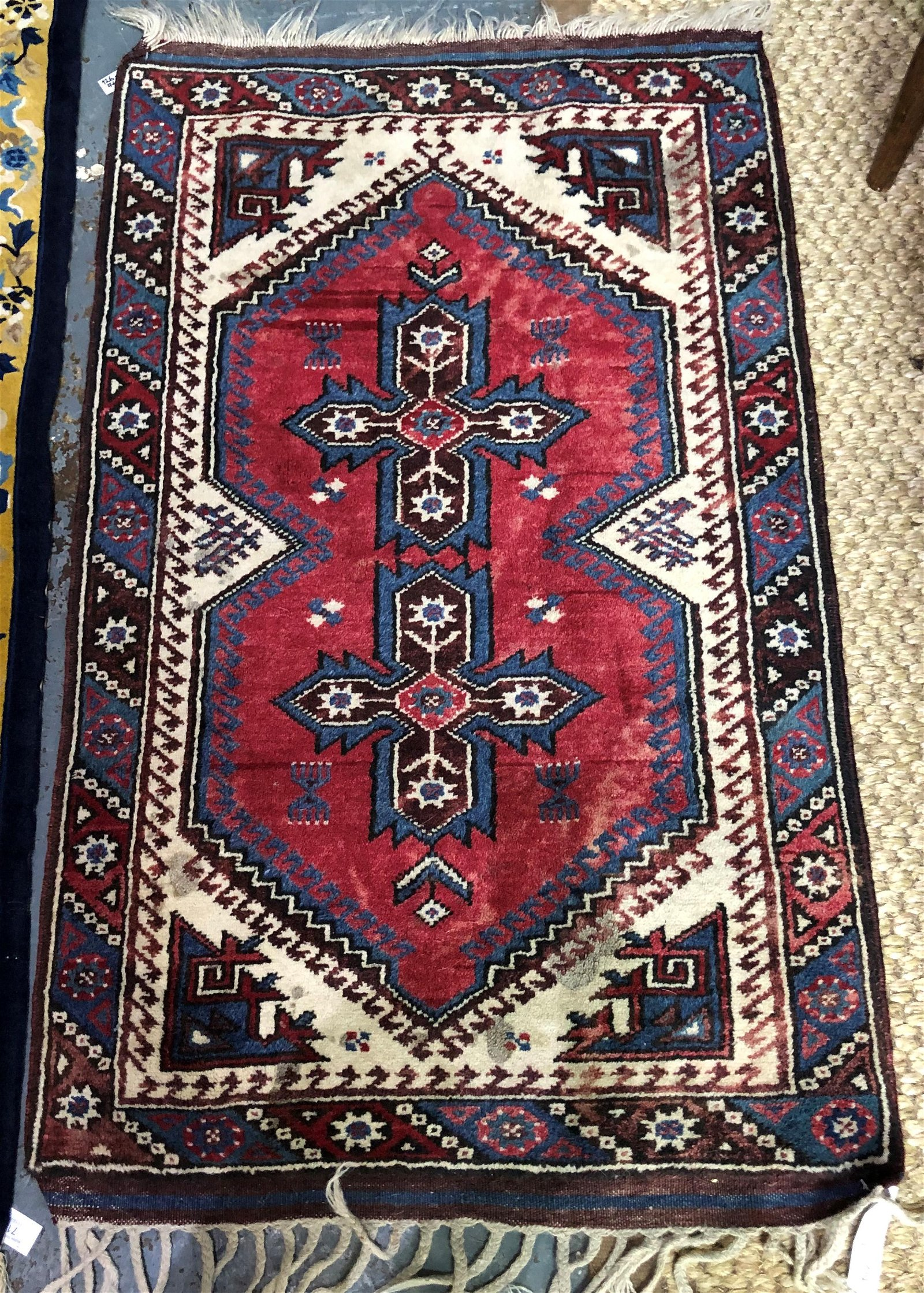 A contemporary Turkish rug, the twin lozenge design on