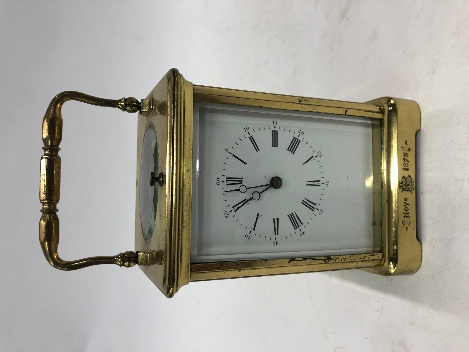 A 19th century French brass carriage clock, the two