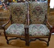 A pair of continental walnut framed open armchairs