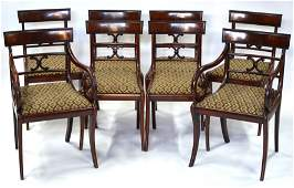 A set of eight Regency figured mahogany bar back dining