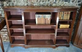 An Edwardian breakfront mahogany library open low