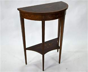 A small antique demi lune side table