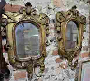 A near pair of mirror backed giltwood framed mirrors