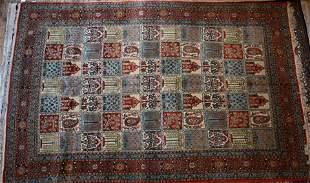 A Persian Qum carpet, 335 cm x 21 cm