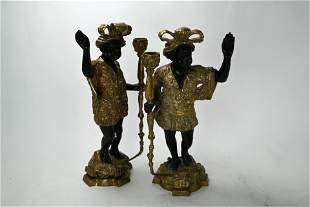 A pair of bronze candlesticks, modelled as