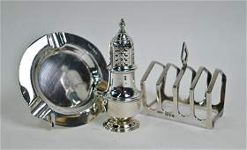 Silver toastrack, caster and ashtray