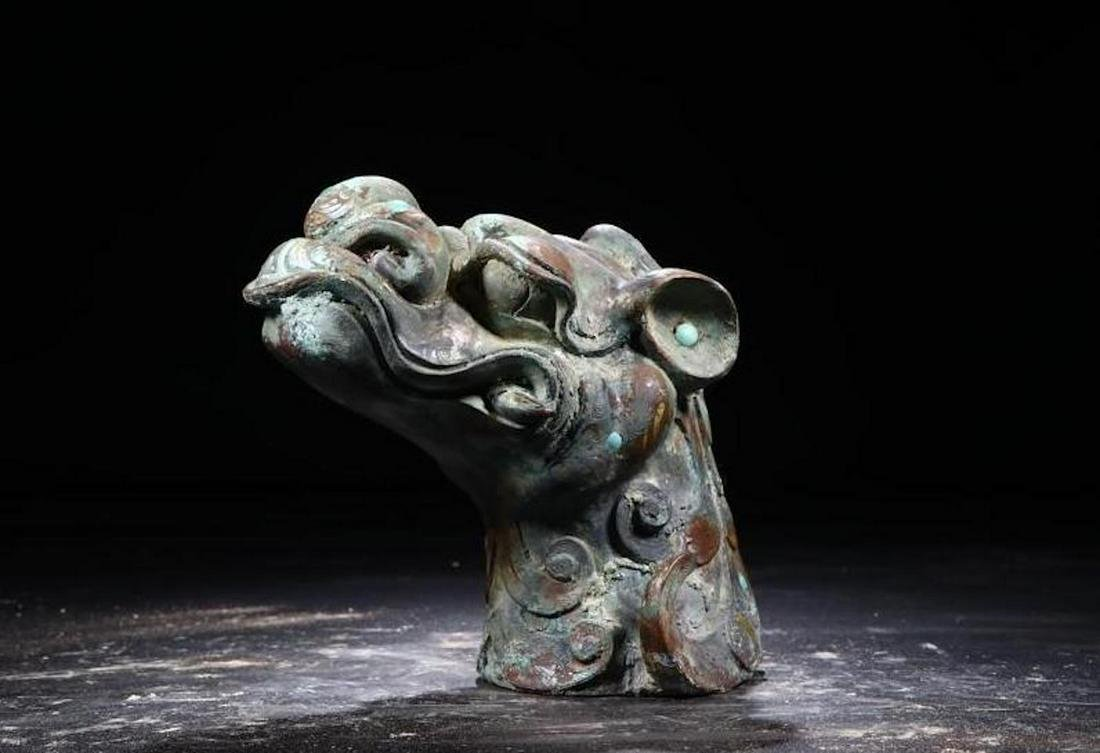 A CHINESE ARCHAIC BRONZE WITH TURQUOISE MYTHICAL BEAST
