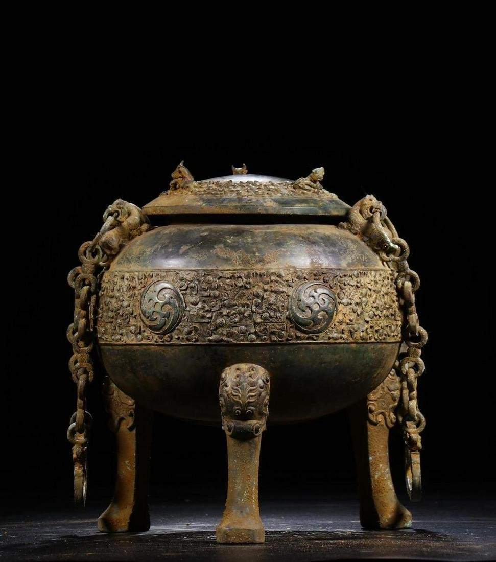 A CHINESE ARCHAIC BRONZE TRIPOD CENSER, QING DYNASTY