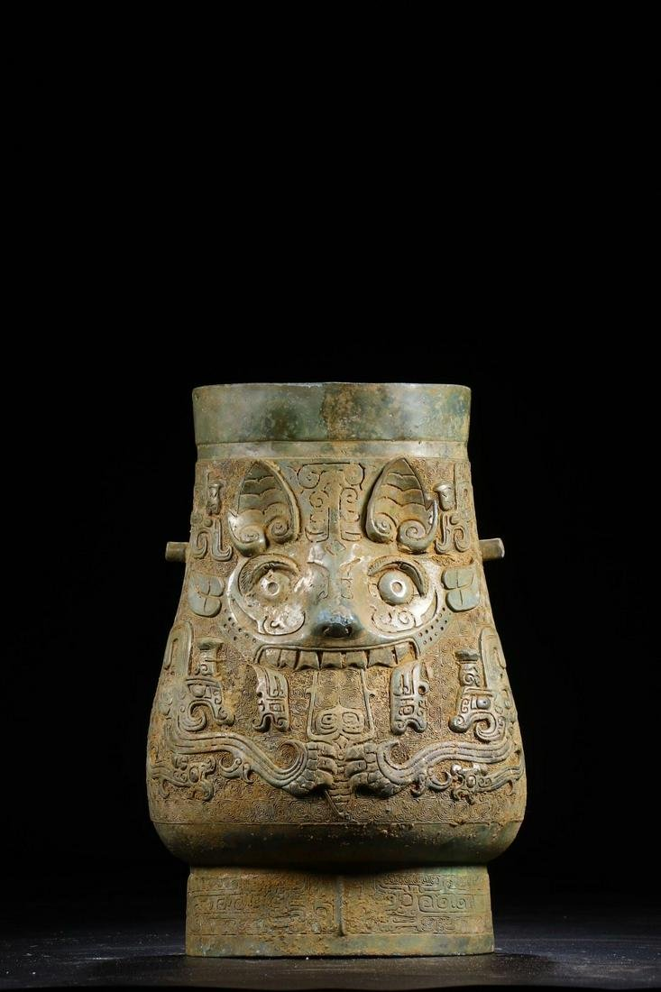 A CHINESE ARCHAIC BRONZE WINE VESSEL WITH MYTHICAL