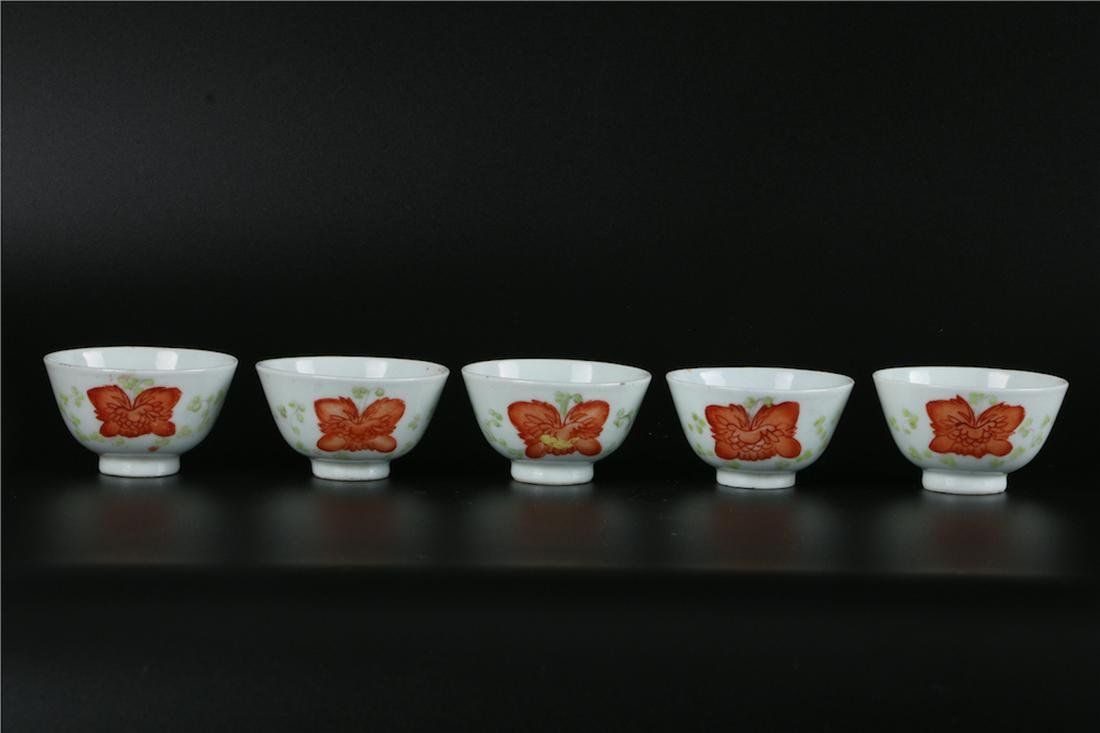 A SET OF FIVE CHINESE IRON-RED PORCELAIN CUPS, REPUBLIC