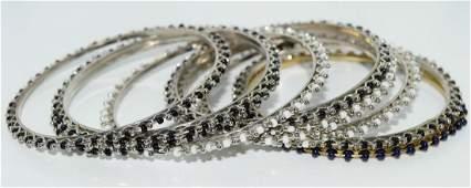 Set of 10 silver tone bead bangle bracelets