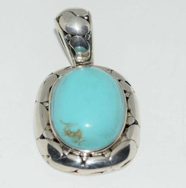 Sterling Pebble Design Turquoise Color Pendant