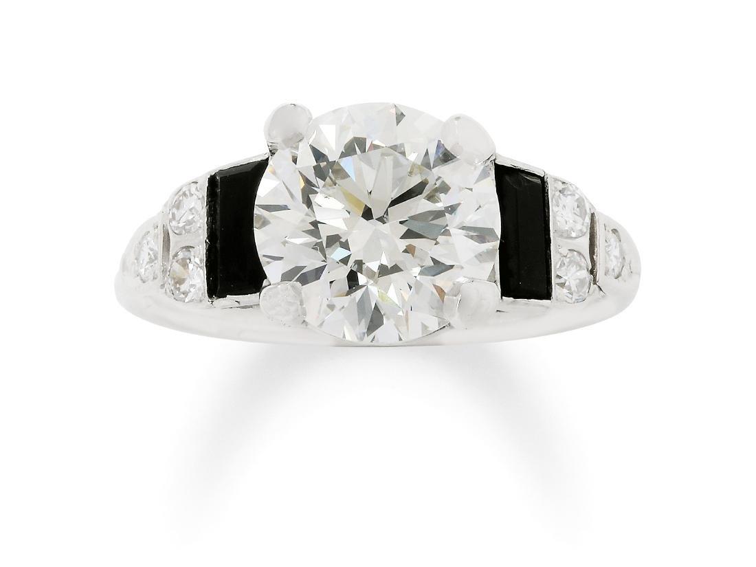 An Art Deco Diamond, Onyx and Platinum Ring, circa 1930