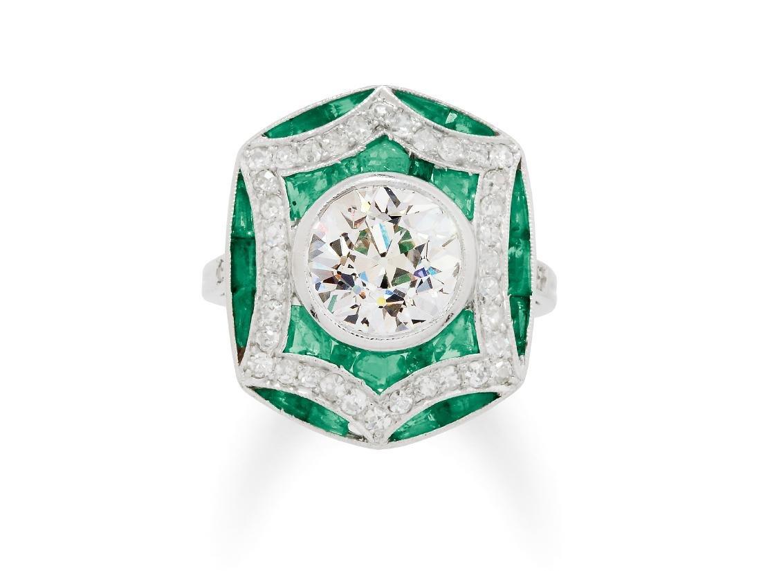 An Art Deco Diamond, Emerald and Platinum Ring, circa
