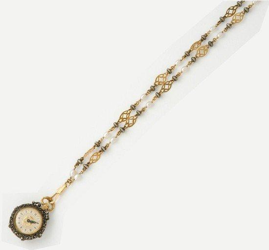 11: Orologio in argento e oro