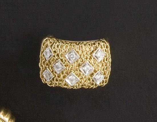 11: Anello in oro giallo 18 kt, punzoni di Legnazzi