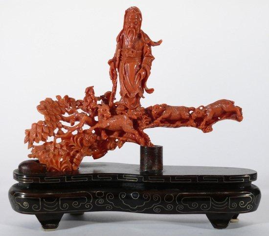 118: Gruppo scultoreo in corallo rosso, su base in leg