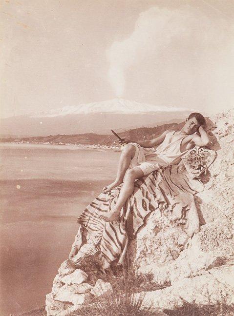 Wilhelm von Gloeden (1856-1931) Young male posed on cli