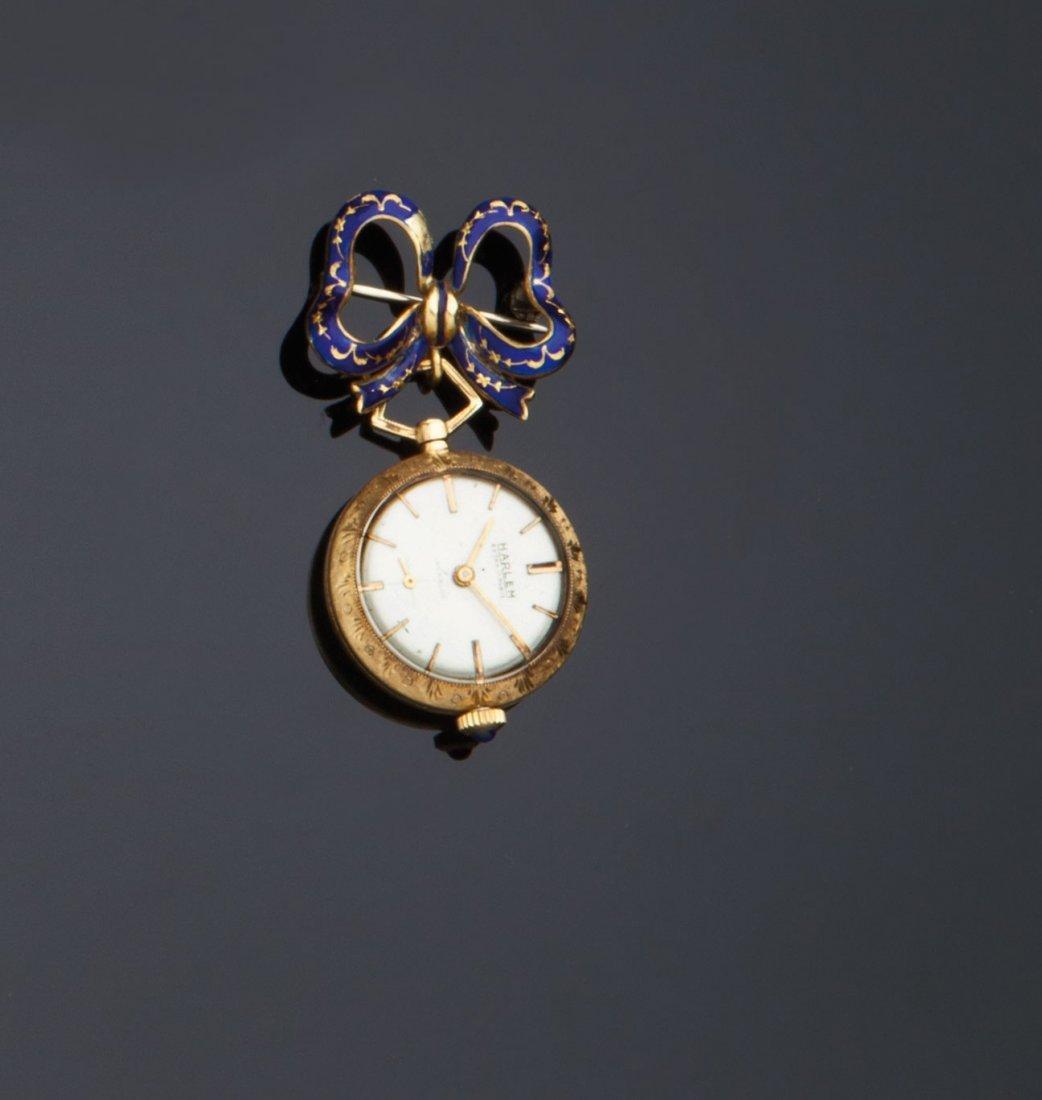 Spilla a fiocco con orologio pendente
