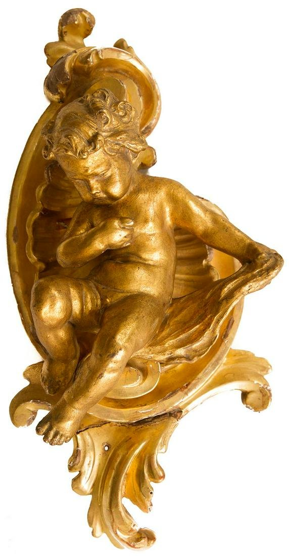 Small golden baked clay wooden putto. H cm 40
